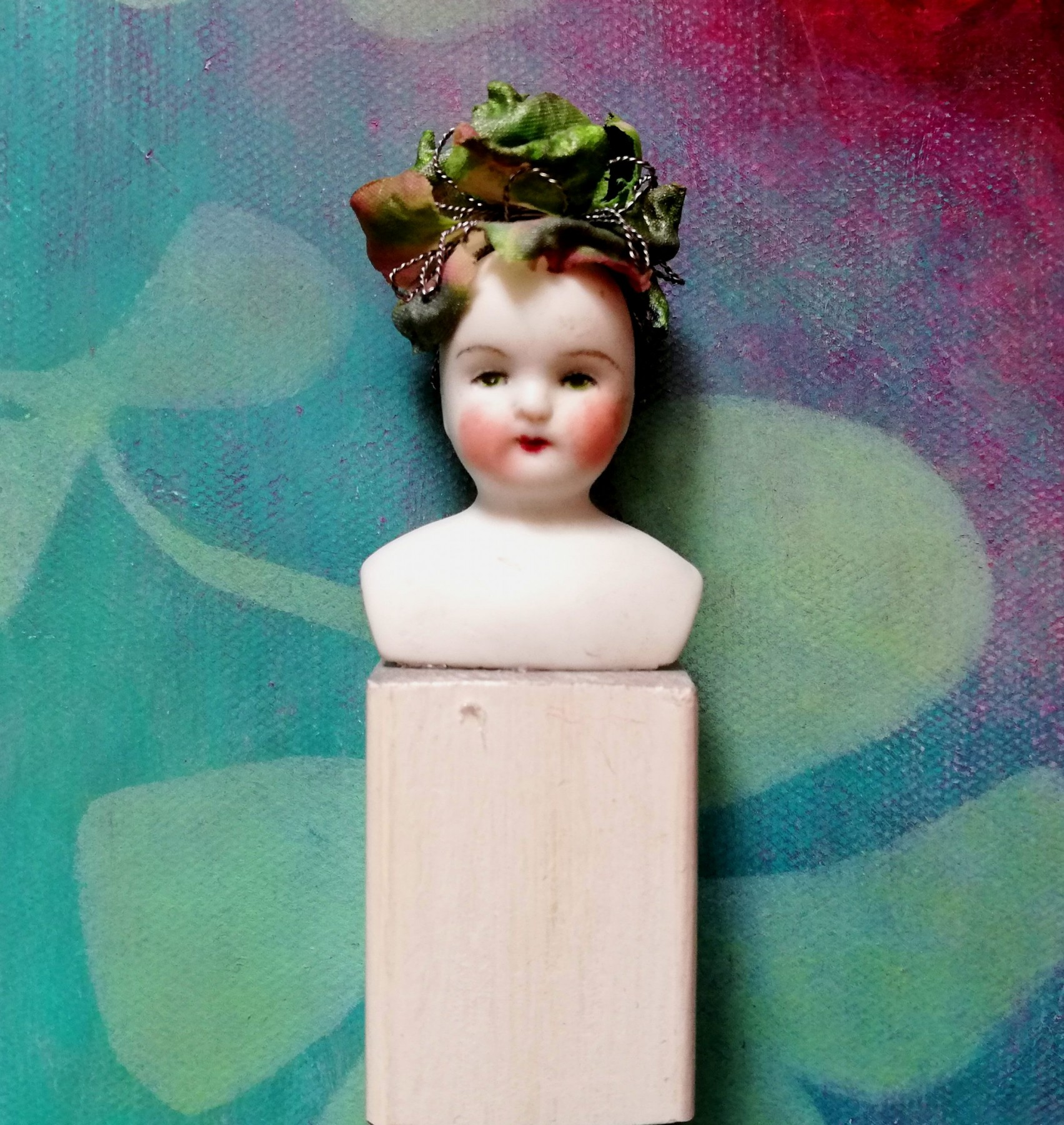 antique porcelain doll <br/> on wooden plinth <br/> 3 x 10cm <br/> £75