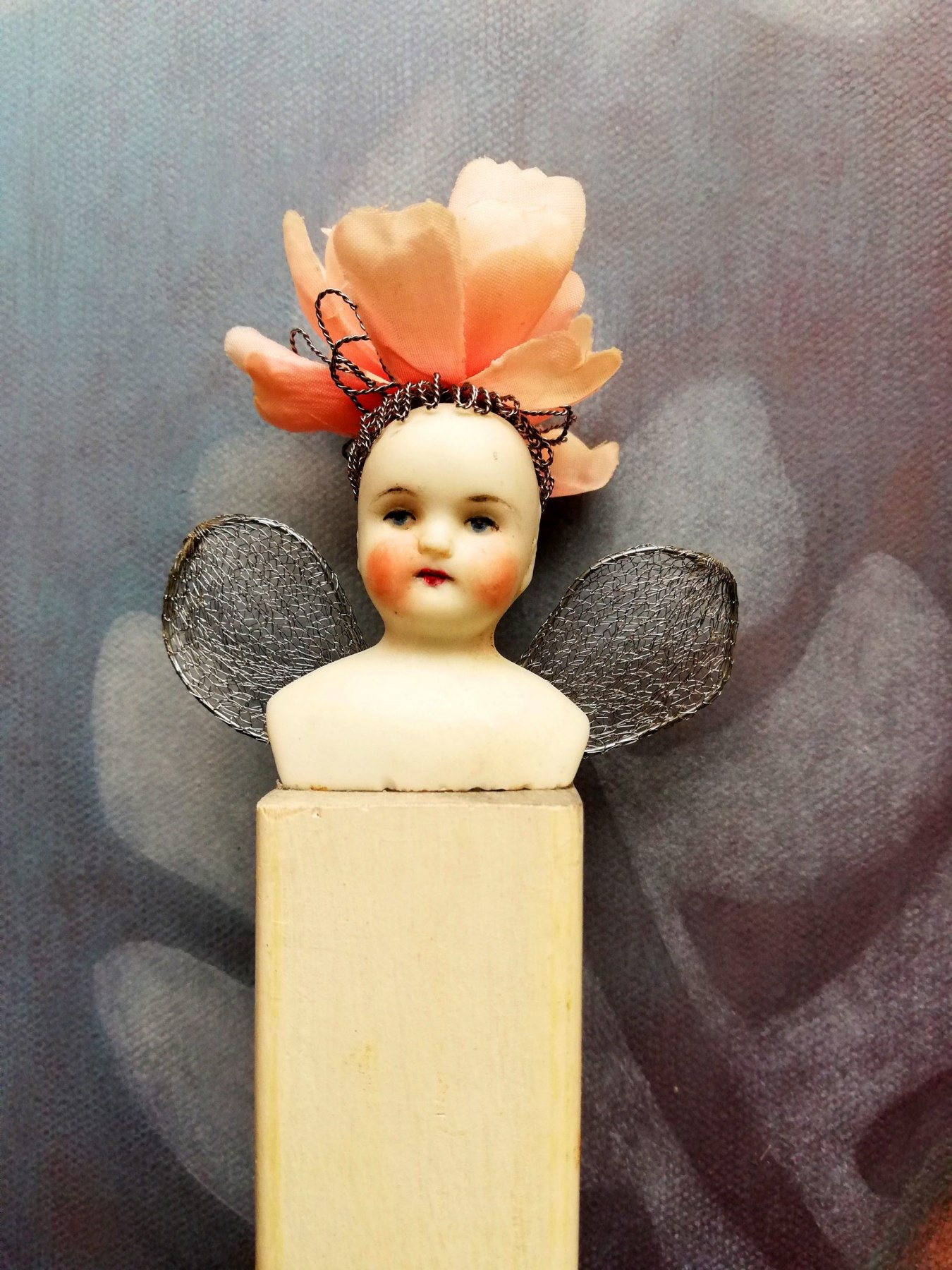 antique porcelain doll <br/> on ooden plinth <br/> 3 x 13cm (excl. wings) <br/> £80
